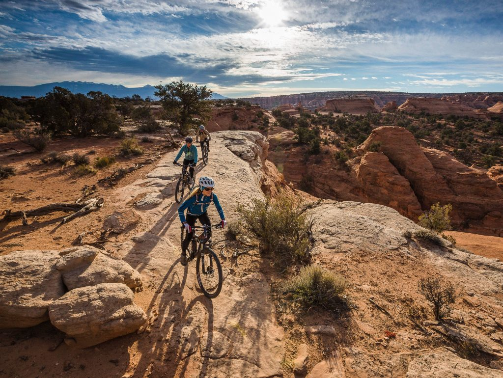 Mountainbiking Magnificent 7 Trail in Moab. Foto Credit Rim Tours