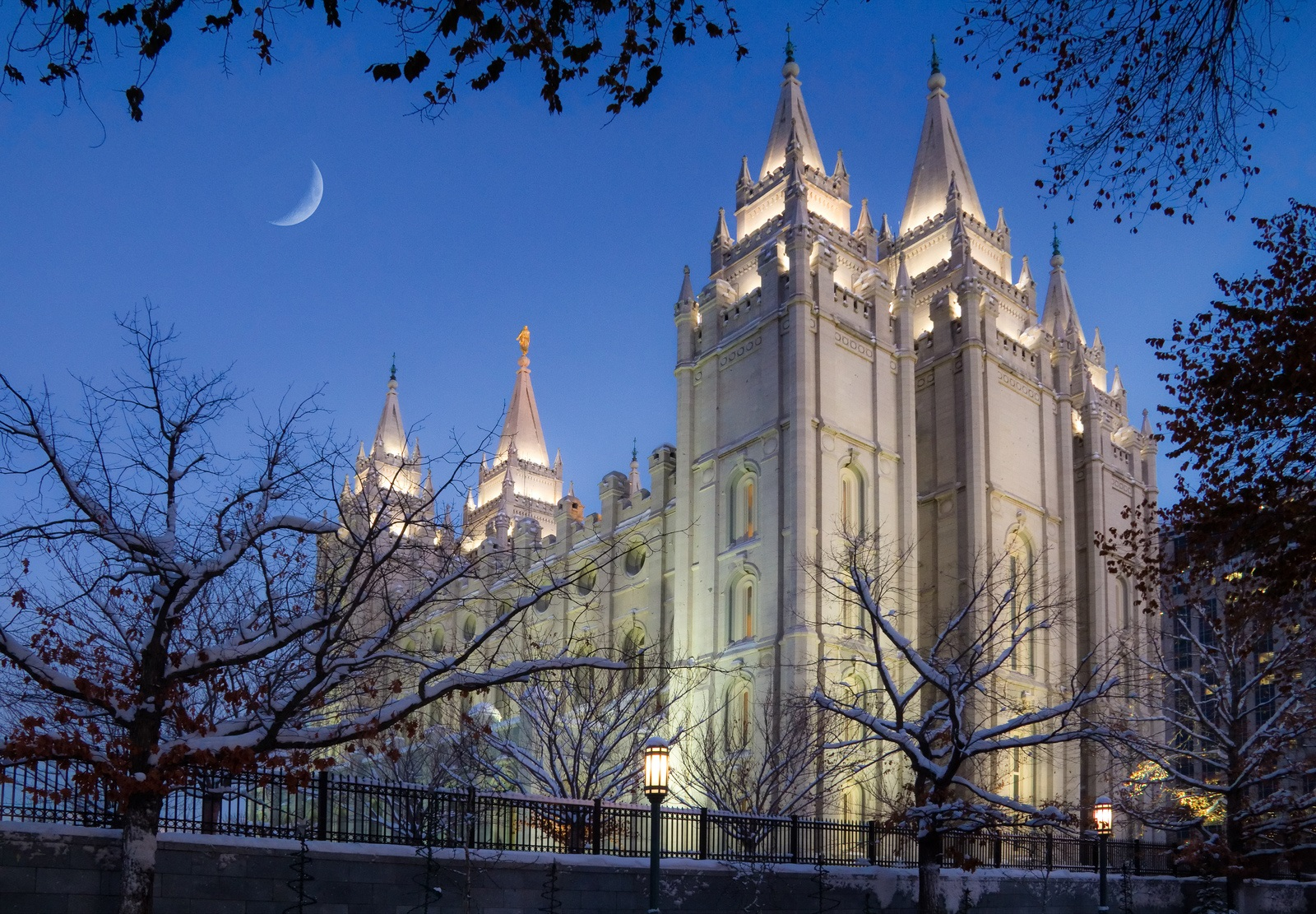 Early evening with a crescent moon over the Mormon Temple in downtown Salt Lake City Utah in wintertime
